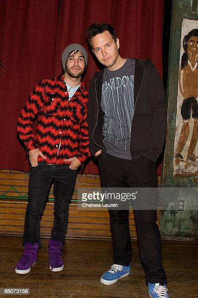 Mark Hoppus of Blink 182 and Pete Wentz of Fall Out Boy pose before selingl tickets to an upcoming Blink 182 concert at the House of Blues Sunset...