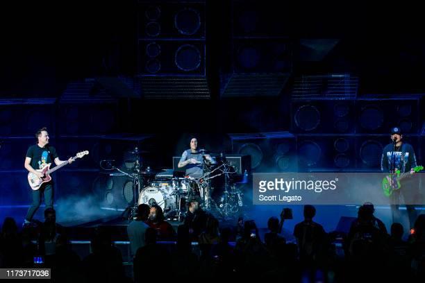 Mark Hoppus Travis Barker and Matt Skiba of Blink182 perform at DTE Energy Music Theater on September 10 2019 in Clarkston Michigan