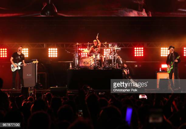 Mark Hoppus Travis Barker and Matt Skiba of blink182 perform onstage at KROQ Weenie Roast 2018 at StubHub Center on May 12 2018 in Carson California