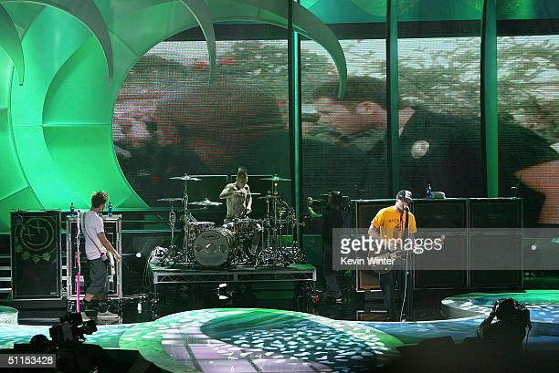 Mark Hoppus Travis Barker and Tom DeLonge of Blink 182 perform 'Down' on stage at The 2004 Teen Choice Awards held at Universal Amphitheater on...