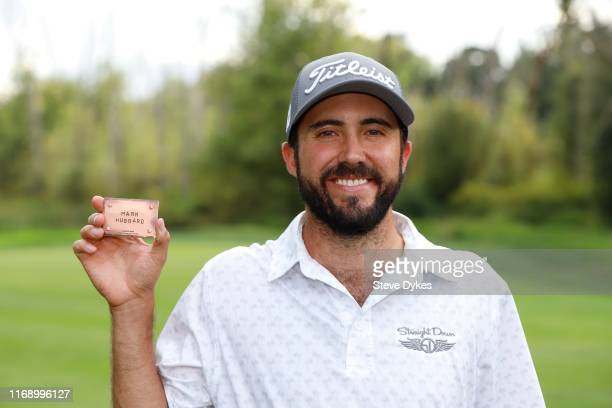 Mark Hubbard holds up his PGA Tour card during the The 25 ceremony after the final round of the WinCo Foods Portland Open presented by KraftHeinz at...