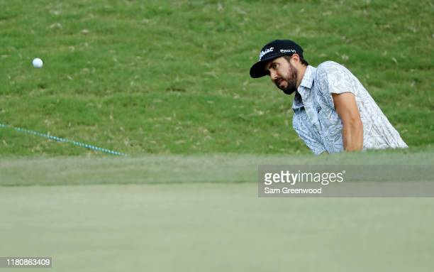 Mark Hubbard plays a shot from a bunker on the 13th hole to make birdie during the final round of the Houston Open at the Golf Club of Houston on...