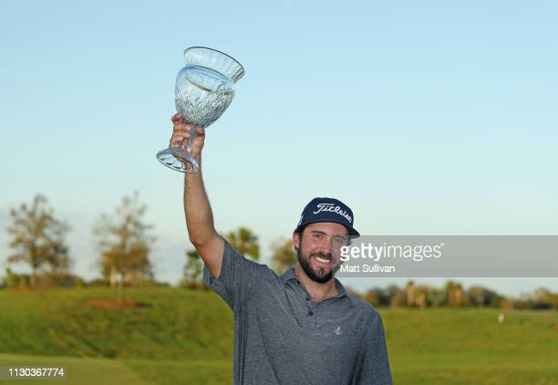 Mark Hubbard poses with the trophy after winning the LECOM Suncoast Classic at Lakewood National Golf Club on February 17 2019 in Lakewood Ranch...
