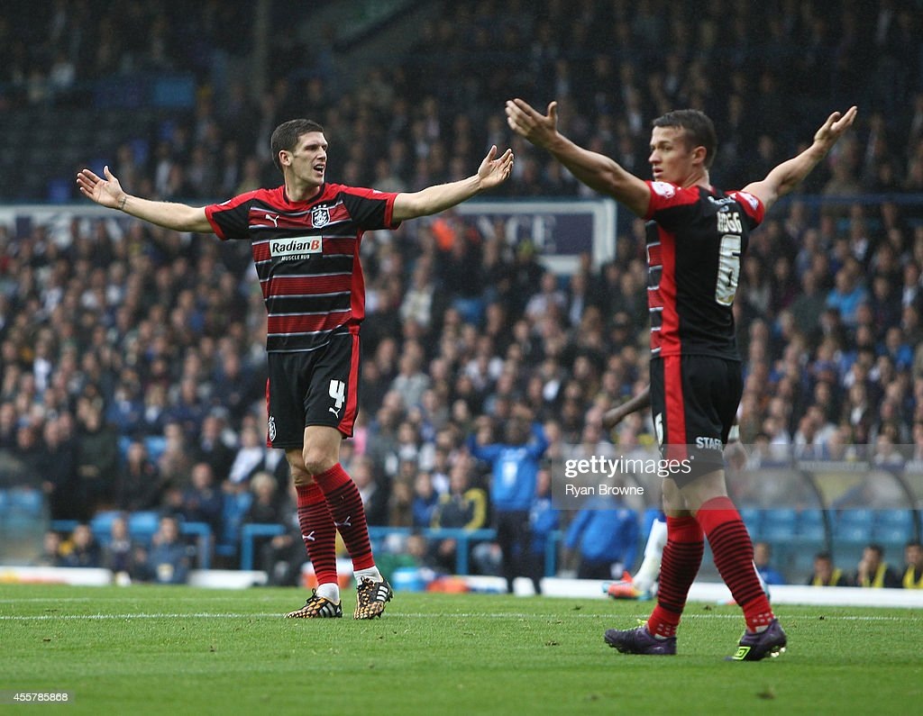 Mark Hudson and Jonathan Hogg of Huddersfield Town appeal for hand ball during Sky Bet Championship match between Leeds United and Huddersfield Town at Elland Road Stadium on September 20, 2014 in Leeds, United Kingdom.