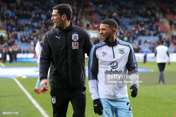 Mark Hudson coach of Huddersfield Town and Nahki Wells of Burnley during the Premier League match between Huddersfield Town and Burnley at John...