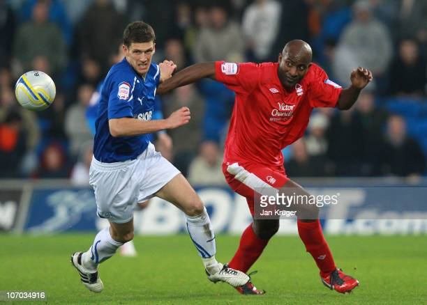 Mark Hudson of Cardiff City and Dele Adebola of Nottingham Forest sets off after a loose ball during the npower Championship match between Cardiff...