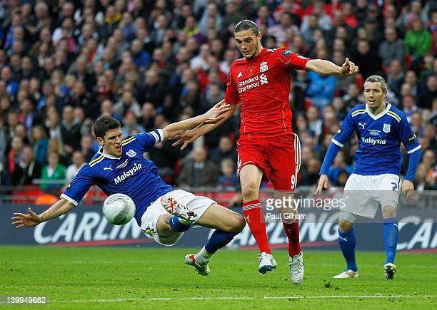 Mark Hudson of Cardiff City challenges Andy Carroll of Liverpool during the Carling Cup Final match between Liverpool and Cardiff City at Wembley...