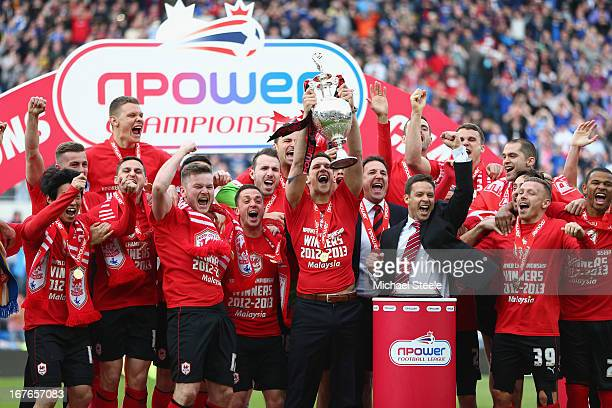 Mark Hudson of Cardiff City lifts the Championship trophy after the npower Championship match between Cardiff City and Bolton Wanderers at the...
