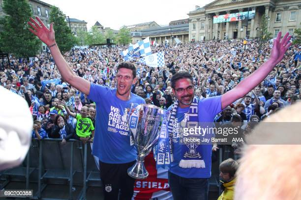 Mark Hudson of Huddersfield Town and David Wagner head coach / manager of Huddersfield Town lift the Sky Bet Championship Play offs trophy on May 30...