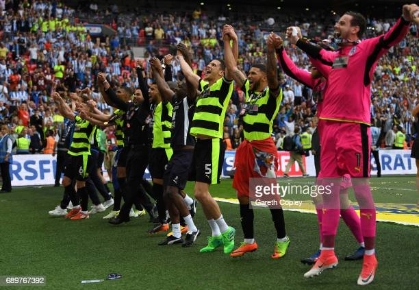 Mark Hudson of Huddersfield Town and his Huddersield Town team mates celebrates promotion to the Premier League after the Sky Bet Championship play...