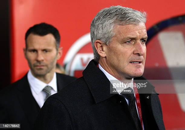 Mark Hughes and Ryan Giggs arrive at half time during the Gary Speed Memorial International Match between Wales and Costa Rica at the Cardiff City...