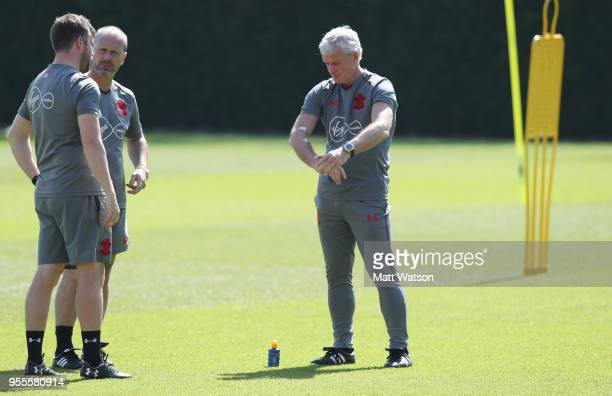 Mark Hughes applies sun cream during a Southampton FC training session at the Staplewood Campus on May 7 2018 in Southampton England