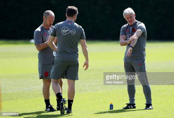 Mark Hughes applies sun crem during a Southampton FC training session at the Staplewood Campus on May 7 2018 in Southampton England