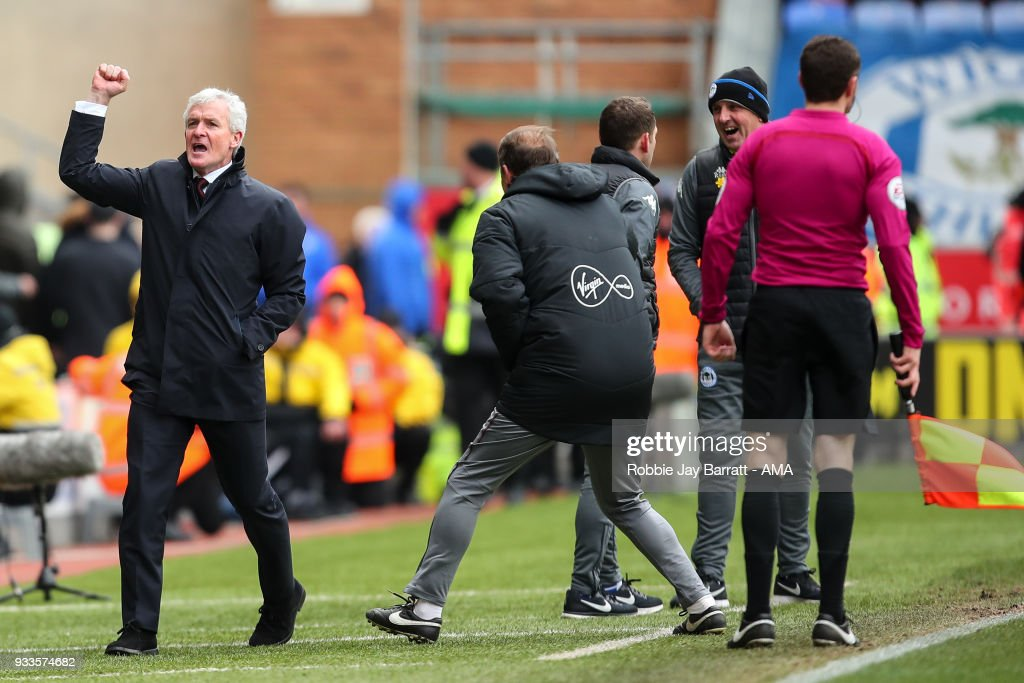 Mark Hughes head coach / manager of Southampton celebrates the second goal during The Emirates FA Cup Quarter Final match at DW Stadium on March 18, 2018 in Wigan, England.