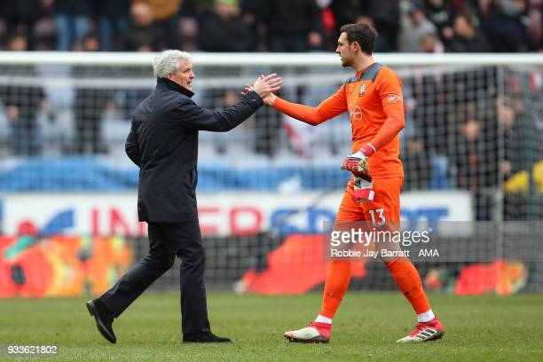 Mark Hughes head coach / manager of Southampton celebrates with Alex McCarthy at full time during The Emirates FA Cup Quarter Final match at DW...