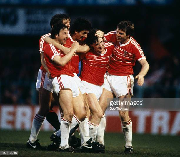 Mark Hughes is congratulated by Mickey Thomas Ian Rush and Robbie James after scoring Wales second goal in a 30 victory over Spain in their FIFA...
