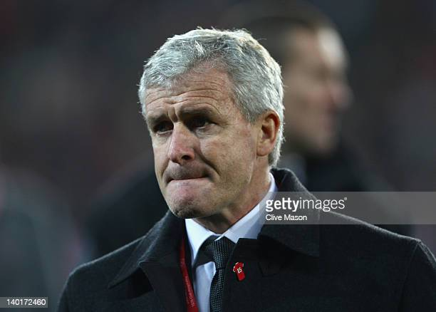 Mark Hughes is seen with several former team mates of the late Gary Speed during the Gary Speed Memorial International Match between Wales and Costa...