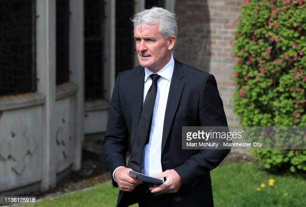 Mark Hughes leaves the service at the Funeral of Manchester City Life President Bernard Halford at St Mary's Church in Manchester on April 10 2019 in...