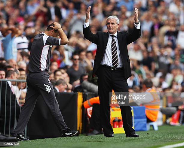 Mark Hughes manager of Fulham reacts after a missed chance during the Barclays Premier League match between Fulham and Manchester United at Craven...