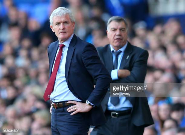 Mark Hughes Manager of Soauthampton and Sam Allardyce Manager of Everton look on during the Premier League match between Everton and Southampton at...