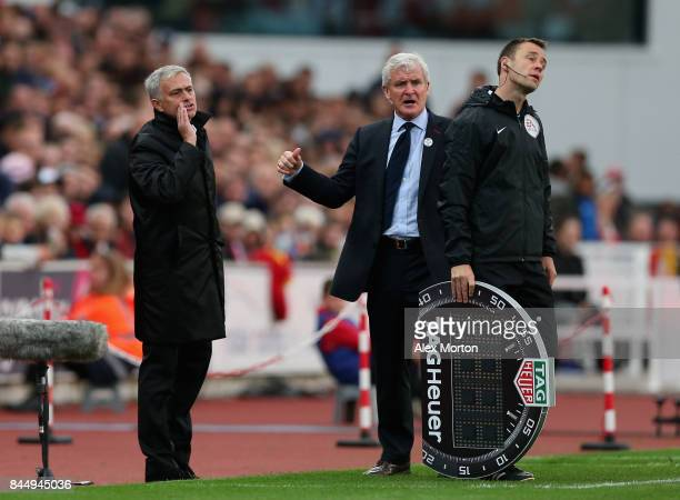 Mark Hughes Manager of Stoke City and Jose Mourinho Manager of Manchester United clash during the Premier League match between Stoke City and...