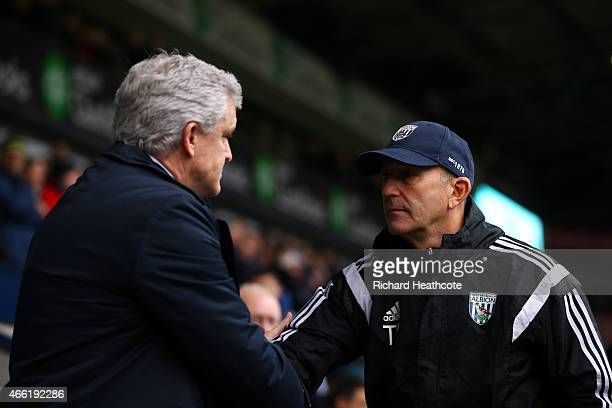 Mark Hughes manager of Stoke City and Tony Pulis manager of West Brom greet each other before the Barclays Premier League match between West Bromwich...