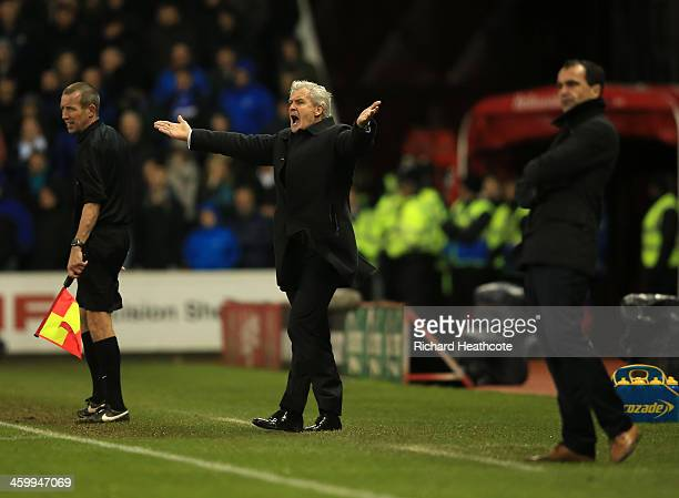 Mark Hughes manager of Stoke City appeals during the Barclays Premier League match between Stoke City and Everton at Britannia Stadium on January 1...