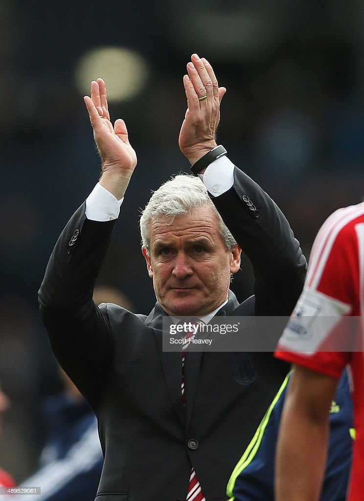 Mark Hughes manager of Stoke City applauds the travelling fans after the Barclays Premier League match between West Bromwich Albion and Stoke City at The Hawthorns on May 11, 2014 in West Bromwich, England.