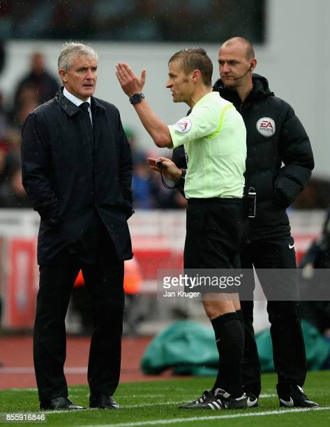 Mark Hughes Manager of Stoke City argues with referee Mike Jones during the Premier League match between Stoke City and Southampton at Bet365 Stadium...