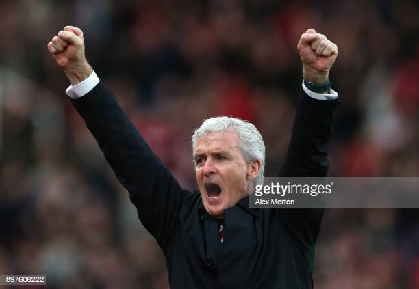 Mark Hughes Manager of Stoke City celebrates his sides first goal during the Premier League match between Stoke City and West Bromwich Albion at...