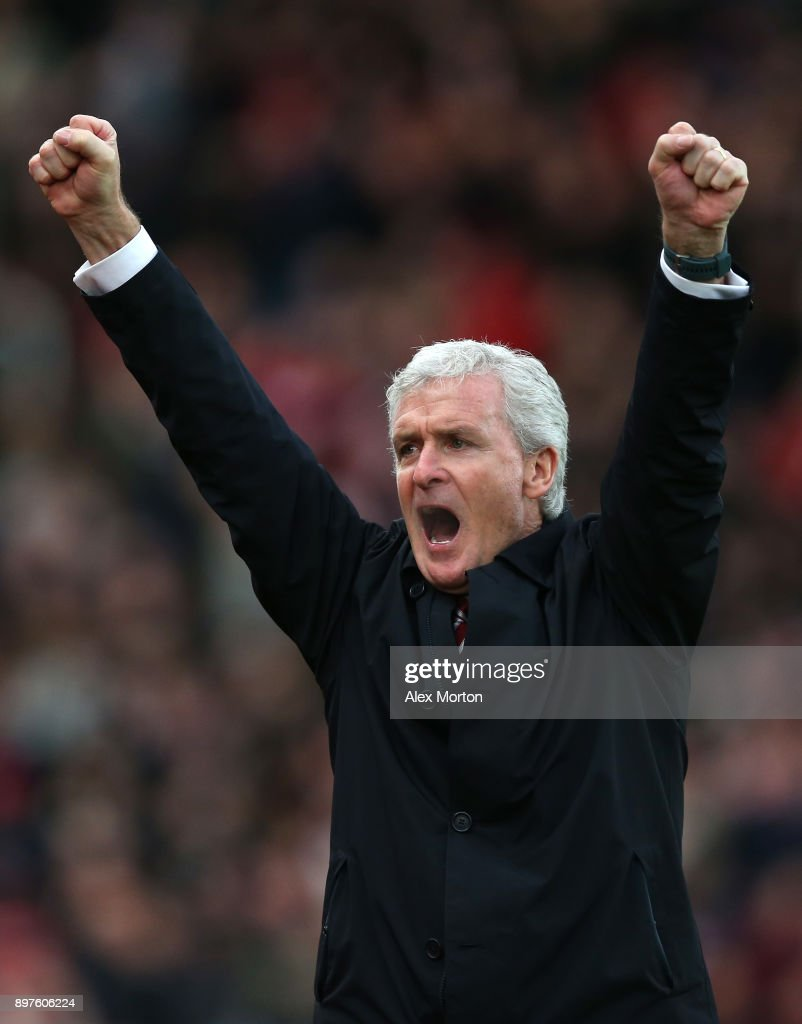 Mark Hughes, Manager of Stoke City celebrates his sides first goal during the Premier League match between Stoke City and West Bromwich Albion at Bet365 Stadium on December 23, 2017 in Stoke on Trent, England.