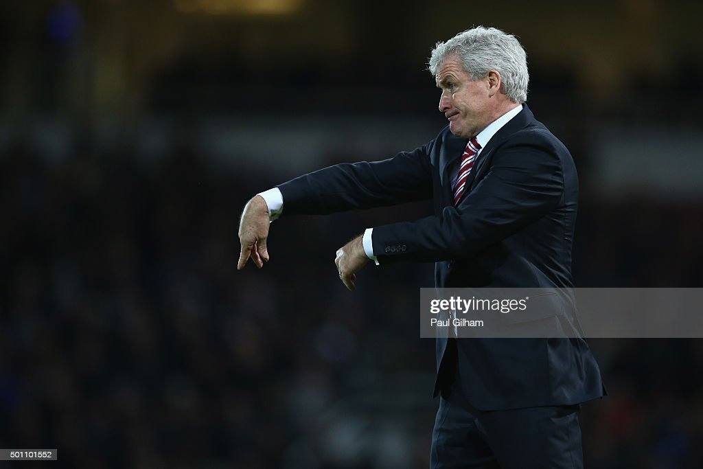 Mark Hughes manager of Stoke City gestures during the Barclays Premier League match between West Ham United and Stoke City at the Boleyn Ground on December 12, 2015 in London, United Kingdom.
