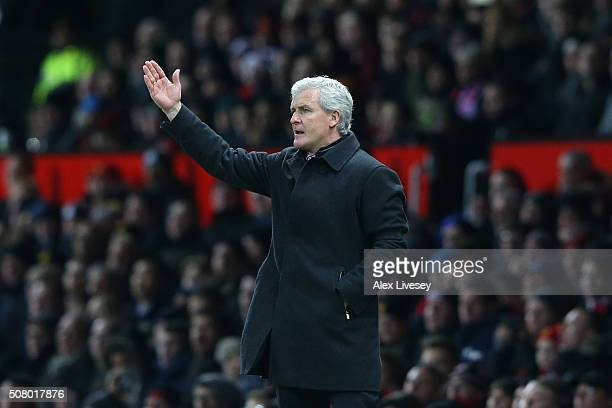 Mark Hughes manager of Stoke City gestures during the Barclays Premier League match between Manchester United and Stoke City at Old Trafford on...