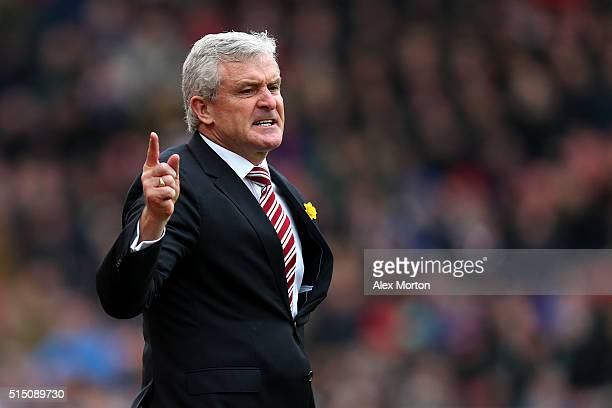 Mark Hughes manager of Stoke City gestures during the Barclays Premier League match between Stoke City and Southampton at Britannia Stadium on March...