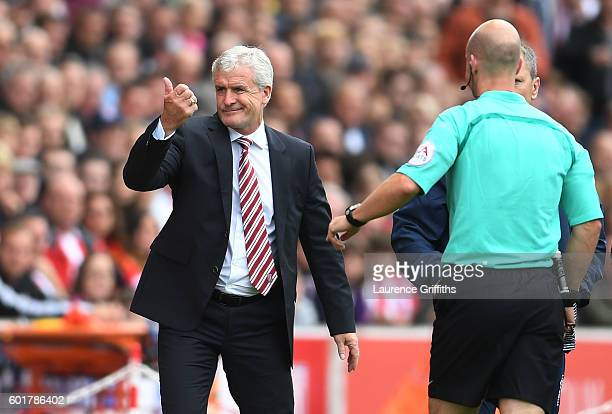Mark Hughes Manager of Stoke City gets sent to the stands during the Premier League match between Stoke City and Tottenham Hotspur at Britannia...