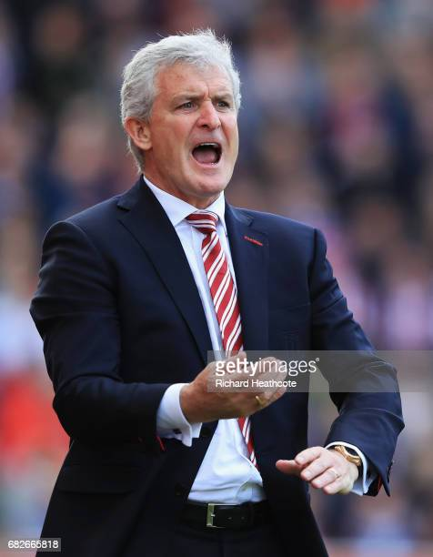 Mark Hughes Manager of Stoke City gives his team instructions during the Premier League match between Stoke City and Arsenal at Bet365 Stadium on May...