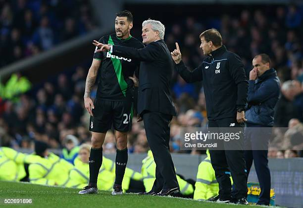 Mark Hughes manager of Stoke City instructs his player Geoff Cameron during the Barclays Premier League match between Everton and Stoke City at...