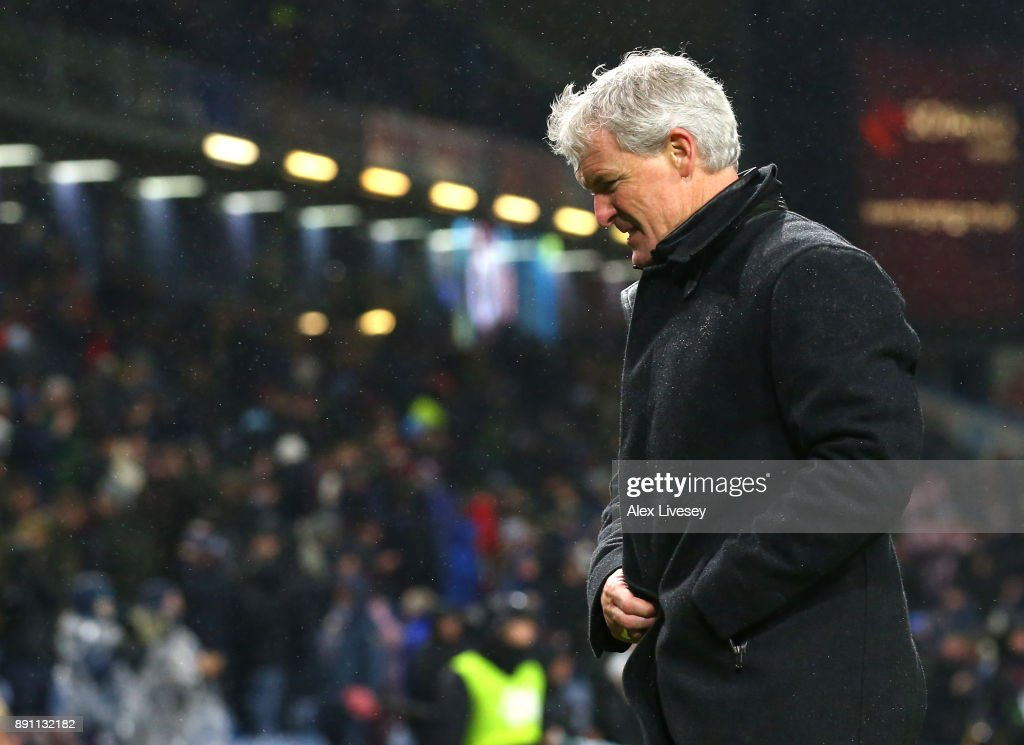 Mark Hughes, Manager of Stoke City looks dejected after the Premier League match between Burnley and Stoke City at Turf Moor on December 12, 2017 in Burnley, England.