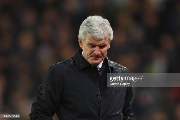 Mark Hughes Manager of Stoke City looks dejected during the Premier League match between Stoke City and Newcastle United at Bet365 Stadium on January...