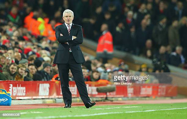Mark Hughes manager of Stoke City looks despondent during the Premier League match between Liverpool and Stoke City at Anfield on December 27 2016 in...
