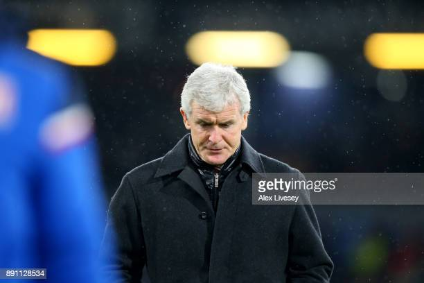 Mark Hughes Manager of Stoke City looks down during the Premier League match between Burnley and Stoke City at Turf Moor on December 12 2017 in...