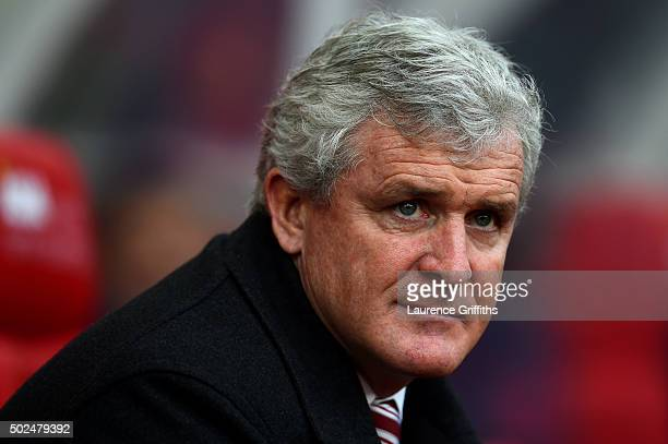 Mark Hughes manager of Stoke City looks on before the Barclays Premier League match between Stoke City and Manchester United at Britannia Stadium on...