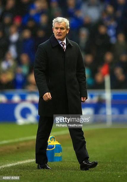 Mark Hughes manager of Stoke City looks on during the Barclays Premier League match between Stoke City and Everton at Britannia Stadium on January 1...