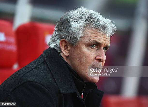 Mark Hughes manager of Stoke City looks on during the Barclays Premier League match between Stoke City and Arsenal at Britannia Stadium on January 17...