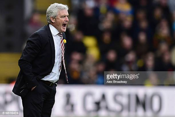 Mark Hughes manager of Stoke City looks on during the Barclays Premier League match between Watford and Stoke City at Vicarage Road on March 19 2016...