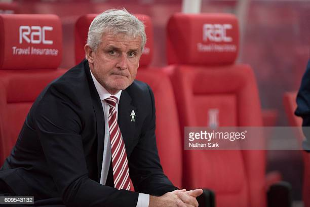 Mark Hughes manager of Stoke City looks on during the EFL Cup Third Round match between Stoke City and Hull City at the Bet365 Stadium on September...