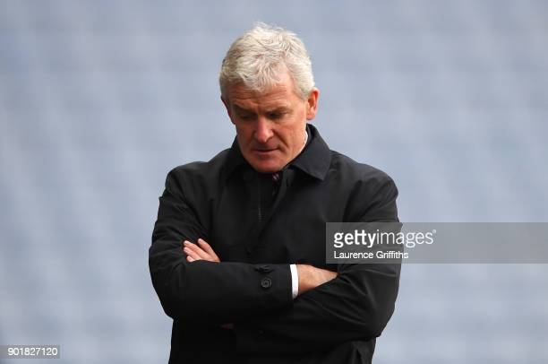 Mark Hughes Manager of Stoke City looks on during The Emirates FA Cup Third Round match between Coventry City and Stoke City at Ricoh Arena on...