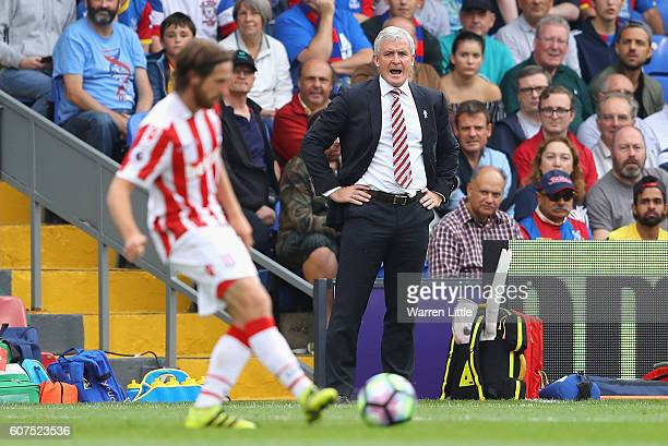 Mark Hughes Manager of Stoke City looks on during the Premier League match between Crystal Palace and Stoke City at Selhurst Park on September 18...