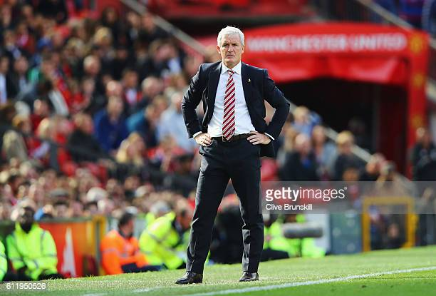 Mark Hughes Manager of Stoke City looks on during the Premier League match between Manchester United and Stoke City at Old Trafford on October 2 2016...
