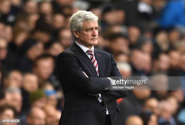 Mark Hughes Manager of Stoke City looks on during the Premier League match between Tottenham Hotspur and Stoke City at White Hart Lane on February 26...